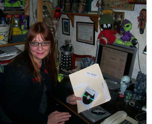 Sue St Clair with copy of The Conspiracy Show